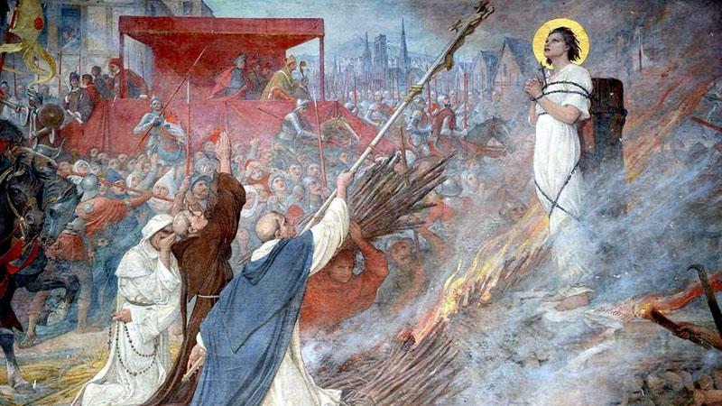 Jeanne d'Arc a máglyán. Freskó az orléans-i szűz szülőfaluja, Domrémy temlomának falán